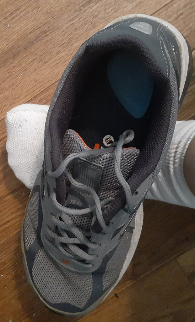 Photo of sneaker on a foot.