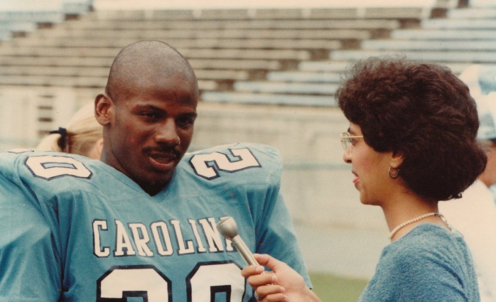 Photo of the writer with UNC football player Amos Lawrence.