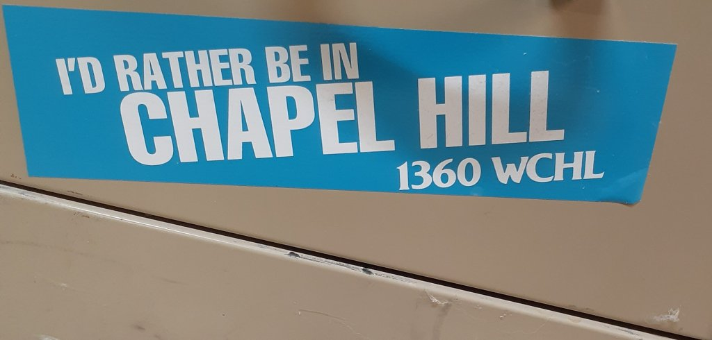 blue and white bumper sticker for WCHL radio