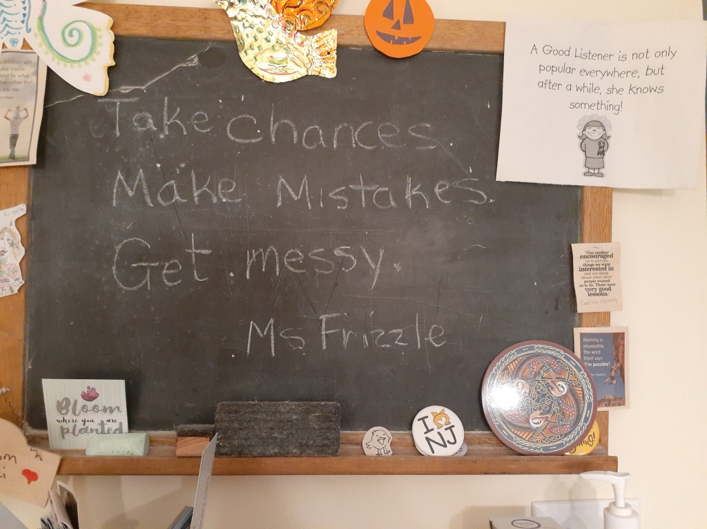 Blackboard with a quote from Miss Frizzle: Take chances; Make mistakes; Get messy.